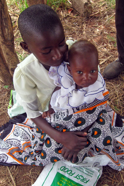 Kenyan Child With Baby