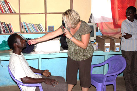 P4P volunteer providing eye exam